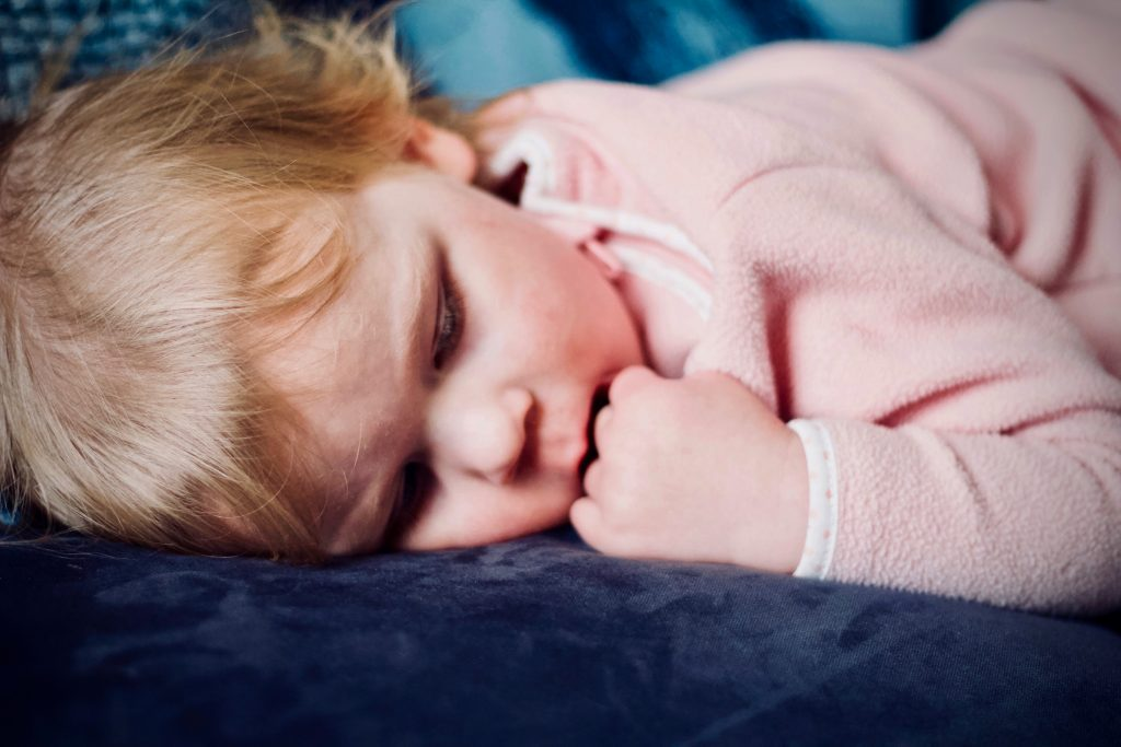 image of child sleeping at daycare center