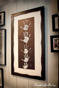 framed photo of handprints