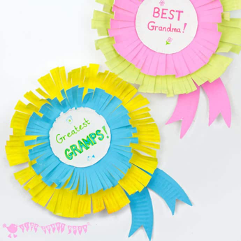 "paper plate rosettes that say ""greatest gramps"" and ""best grandma"" in the center"